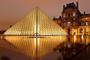 Louvre Museum at sundown, perfectly lit.